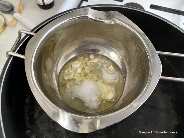 Melting the beeswax, shea butter and coconut oil to make lip balm