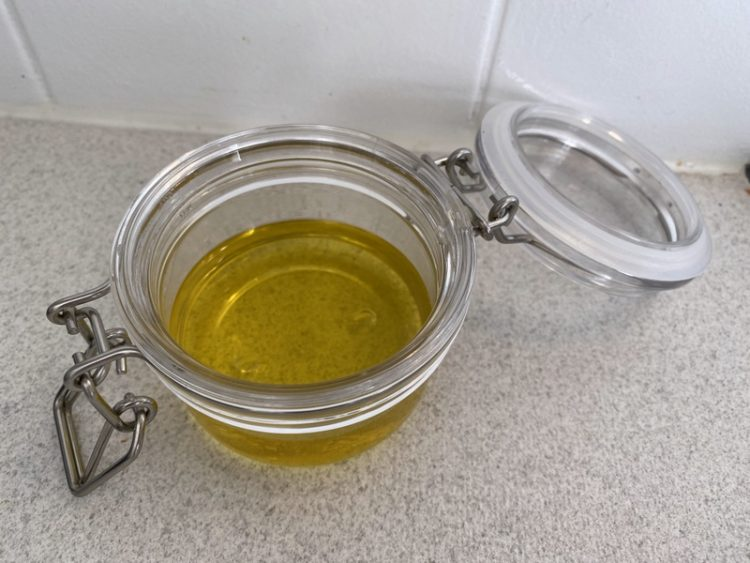 Filling up my bail jar with some freshly made foot balm